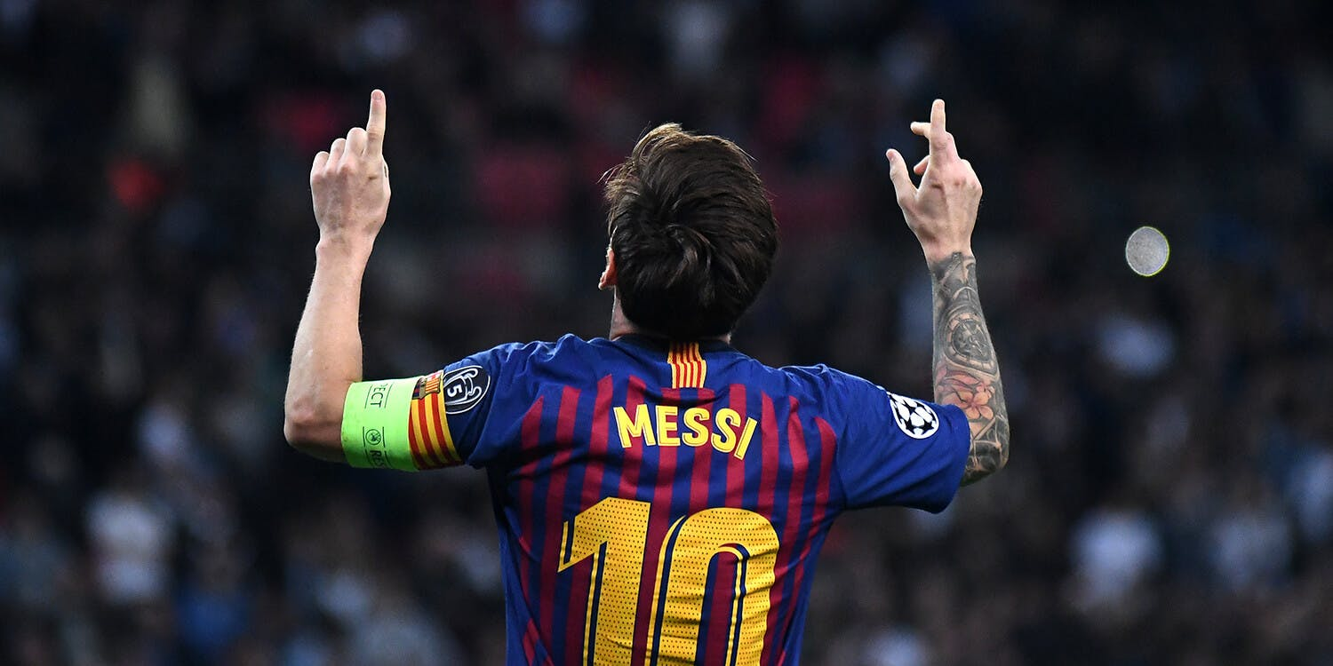 Lionel Messi pointing at the sky