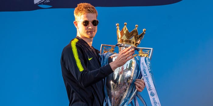 Manchester City player with Premier League trophy