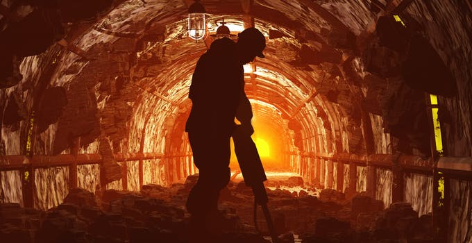 silhouette of miner in shaft