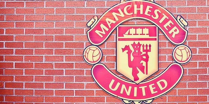 Manchester United logo at Old Trafford