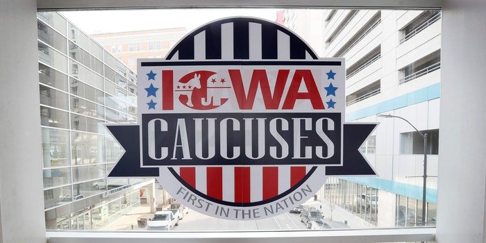 sign for the Iowa caucuses in window