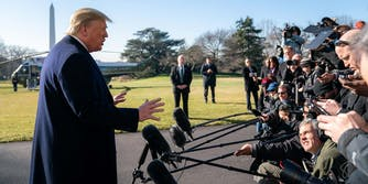 President Donald Trump and reporters outside the White House