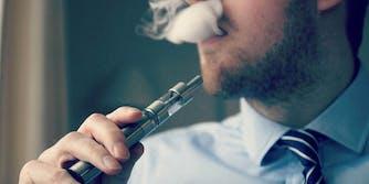 A man using a vaporizer