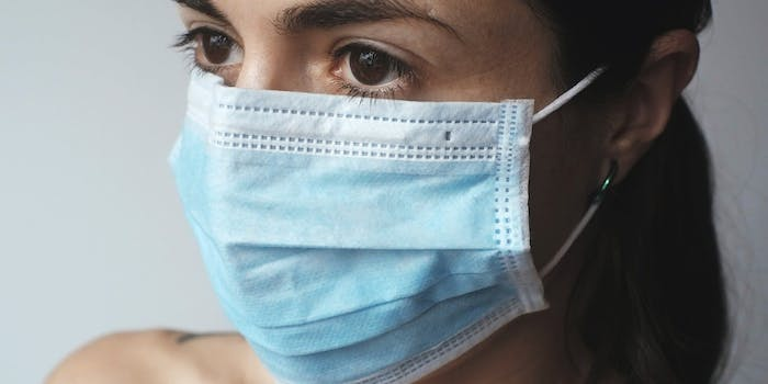 person in medical face mask