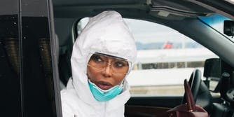 Naomi Campbell - hazmat suit