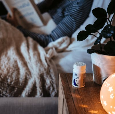 Bottle of MEdterra CBD oil on a nightstand