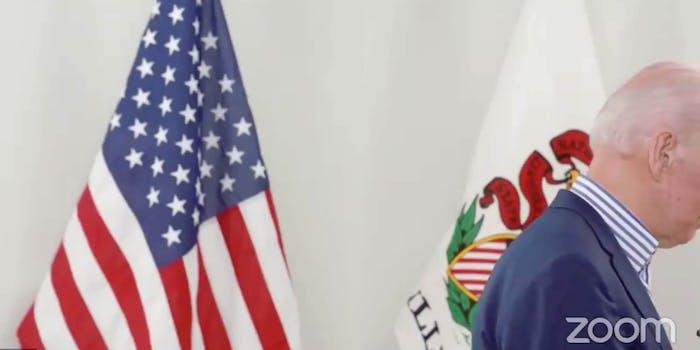 Joe Biden standing slightly off camera in a virtual town hall