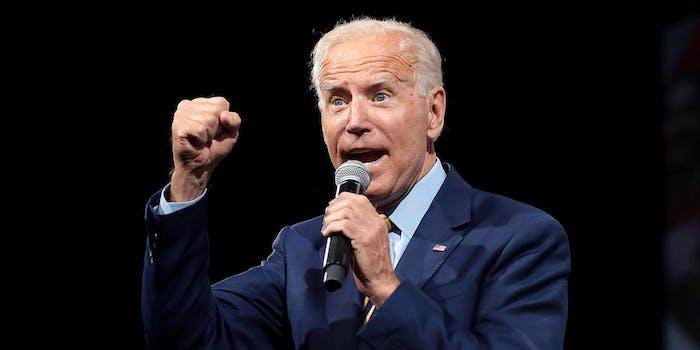 Joe Biden holding a microphone and speaking