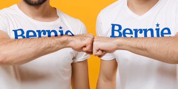 guys in Bernie Sanders shirts fist bumping