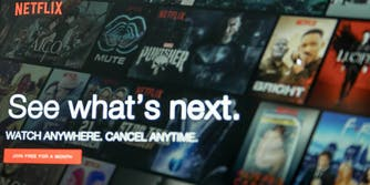A laptop showing the main menu of Netflix