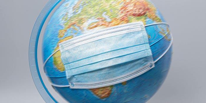 globe of Earth wearing medical mask