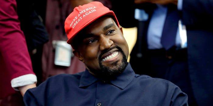 Kanye West smiling while wearing a Make America Great Again hat