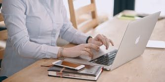 woman on computer looking at weird niche Twitter groups