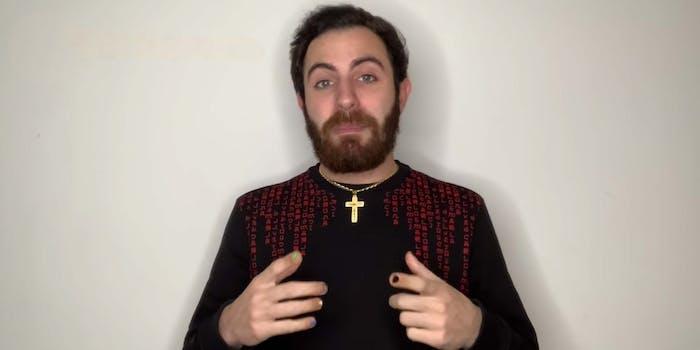 "Italian YouTuber Francesco ""Social Boom"" Belardi standing in front of a camera"