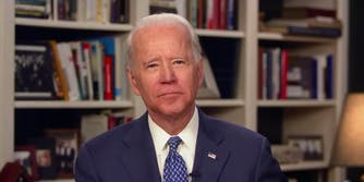 Joe Biden in front of a bookshelf
