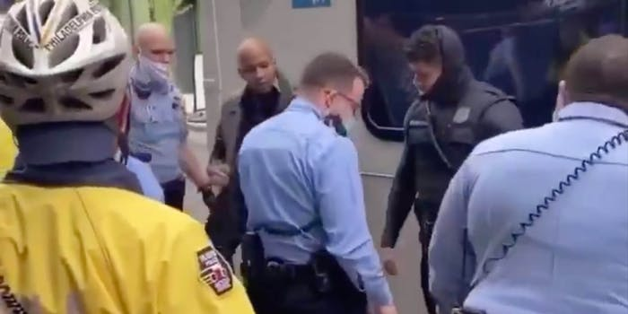 A group of Philadelphia police officers outside of a bus
