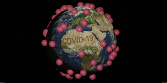 The world covered in red spots with the word COVID-19
