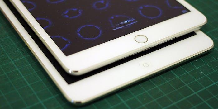 two white iPad minis on a table