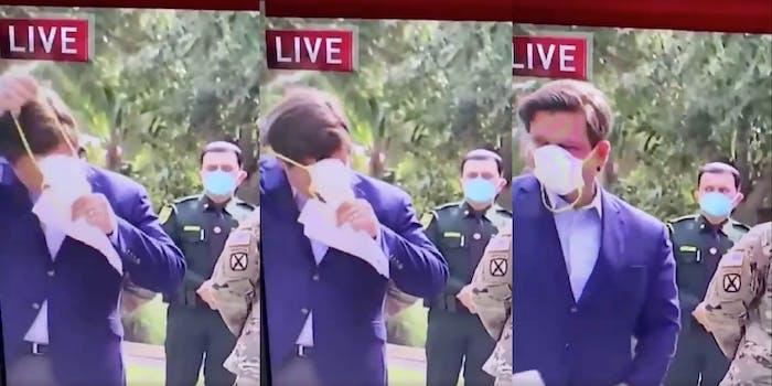 ron desantis putting on a face mask