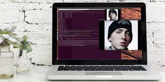 A Macbook with Eminem on the screen