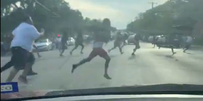 Video shows people running across the street to run from gunshots