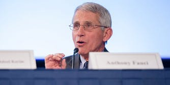 Dr. Anthony Fauci in front of a microphone