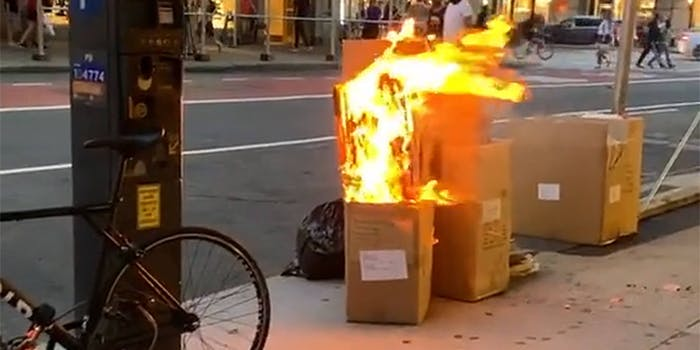 cardboard boxes on fire on NYC street