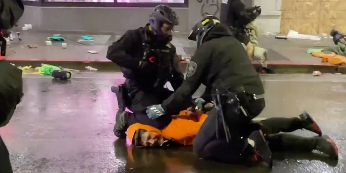 officer knee to protesters neck