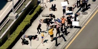A group of protesters doing push-ups and squats