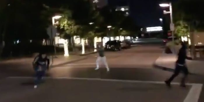 video machete wielding man protesters