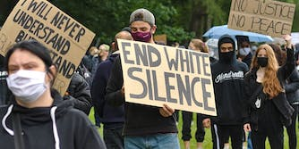 BLM protest sign of white silence