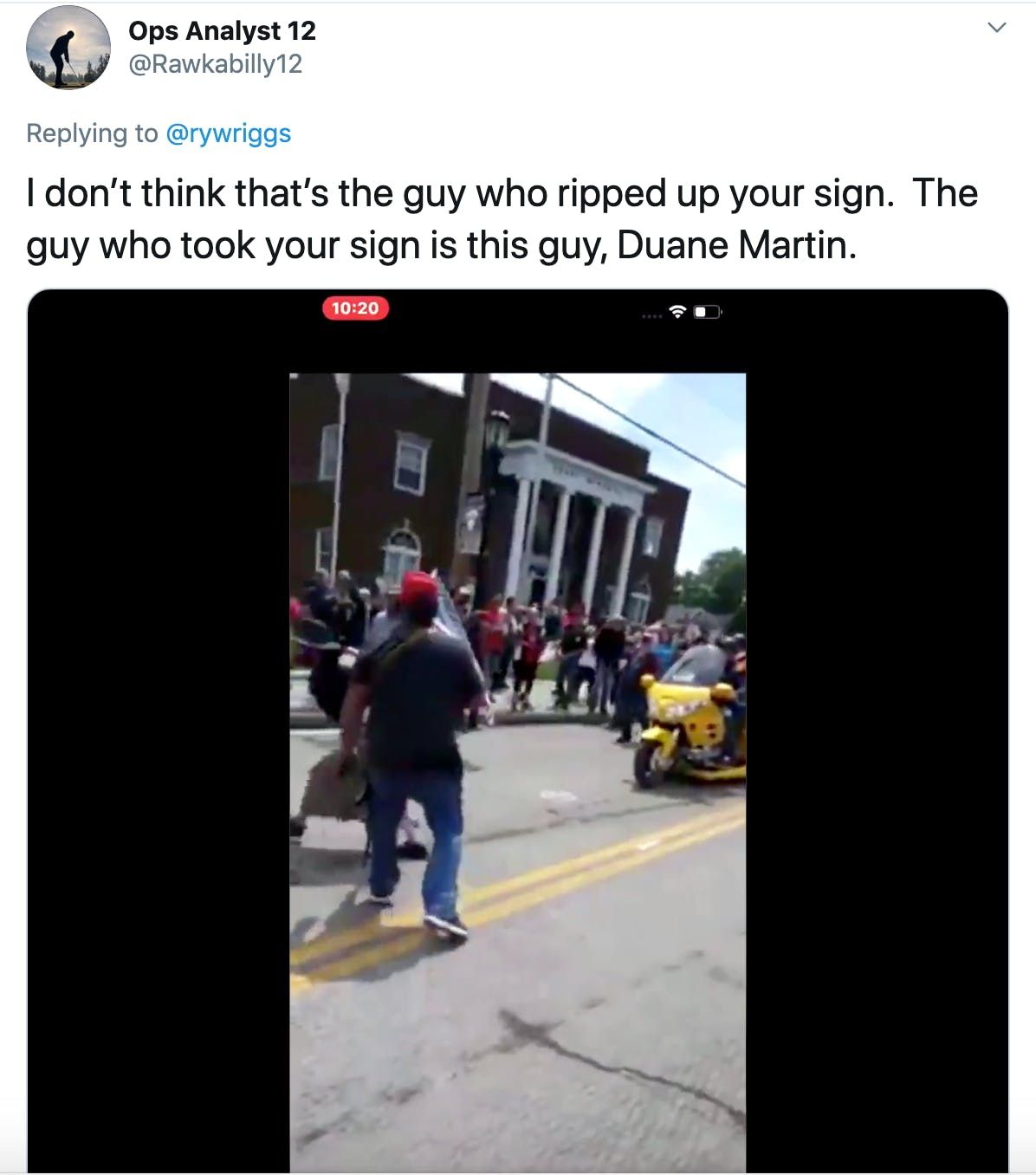 """""""I don't think that's the guy who ripped up your sign.  The guy who took your sign is this guy, Duane Martin."""" followed by an image of a man with a gun lunging at a protester"""