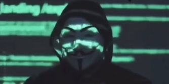 A person in a Guy Fawkes Anonymous mask