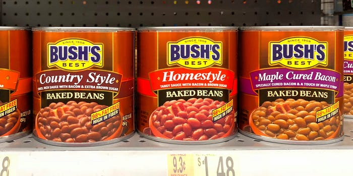 cans of baked beans on store shelf