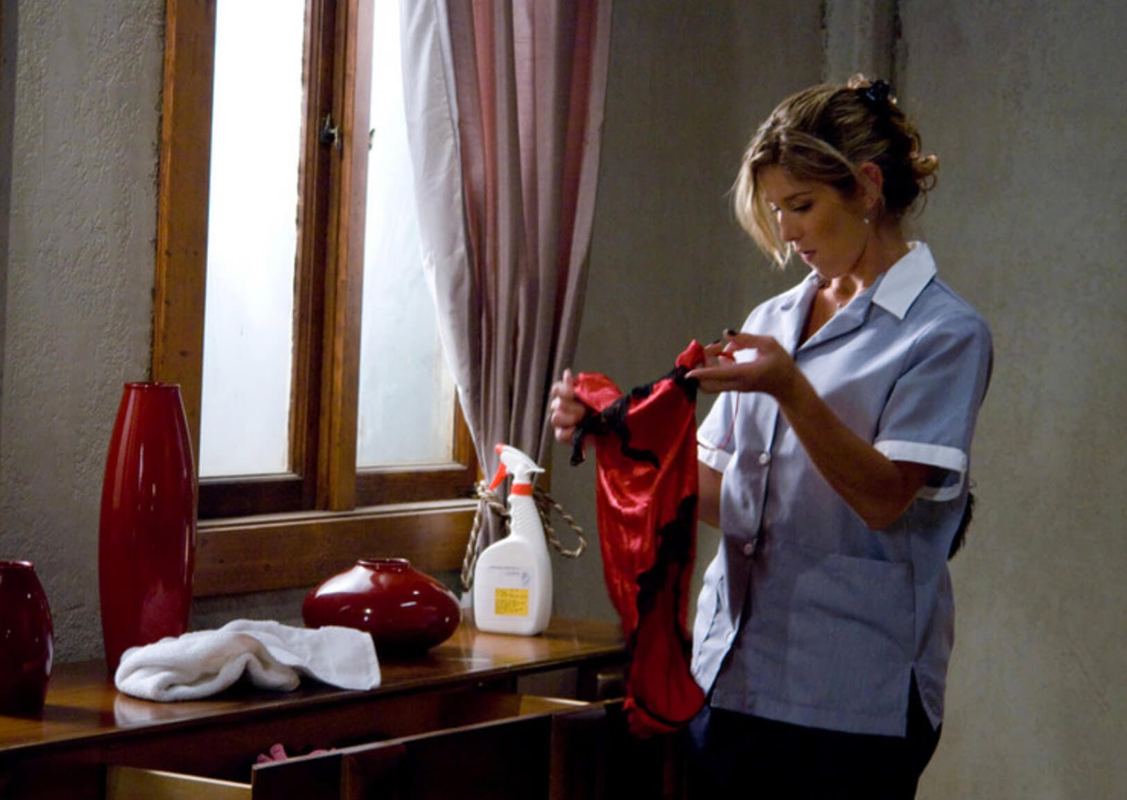A maid is cleaning a room and finds sexy lingerie