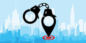 handcuffs made from location data over city background