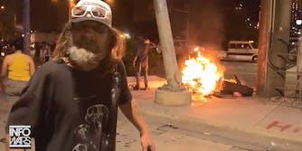 infowars austin homeless man's belonging burn during protest