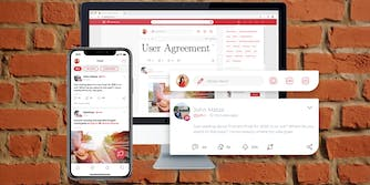 The Parler app against a brick wall
