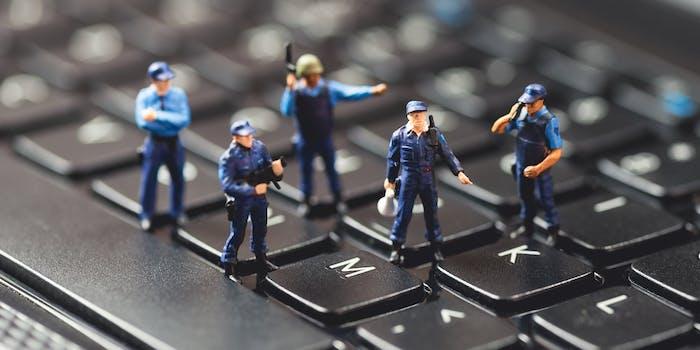 small police figurines on keyboard