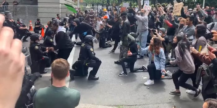 portland police kneel with protesters