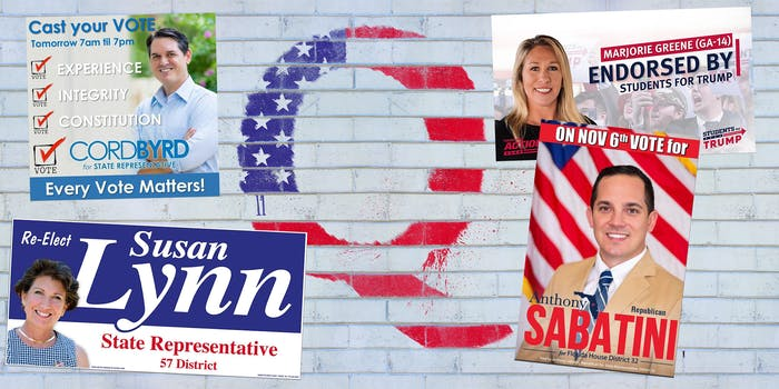 qanon politician flyers on brick wall with spray-painted Q