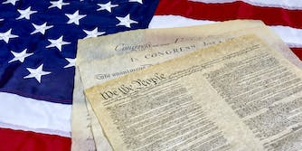 US Constitution and Declaration of Independence on American flag