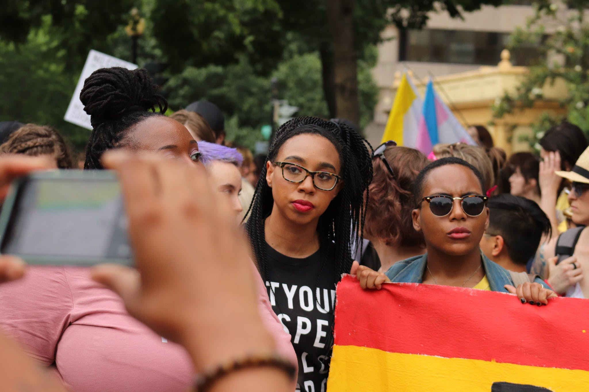 A group of Black queer people marching during an LGBTQ event. Public sex is an important part of the queer community's legacy.