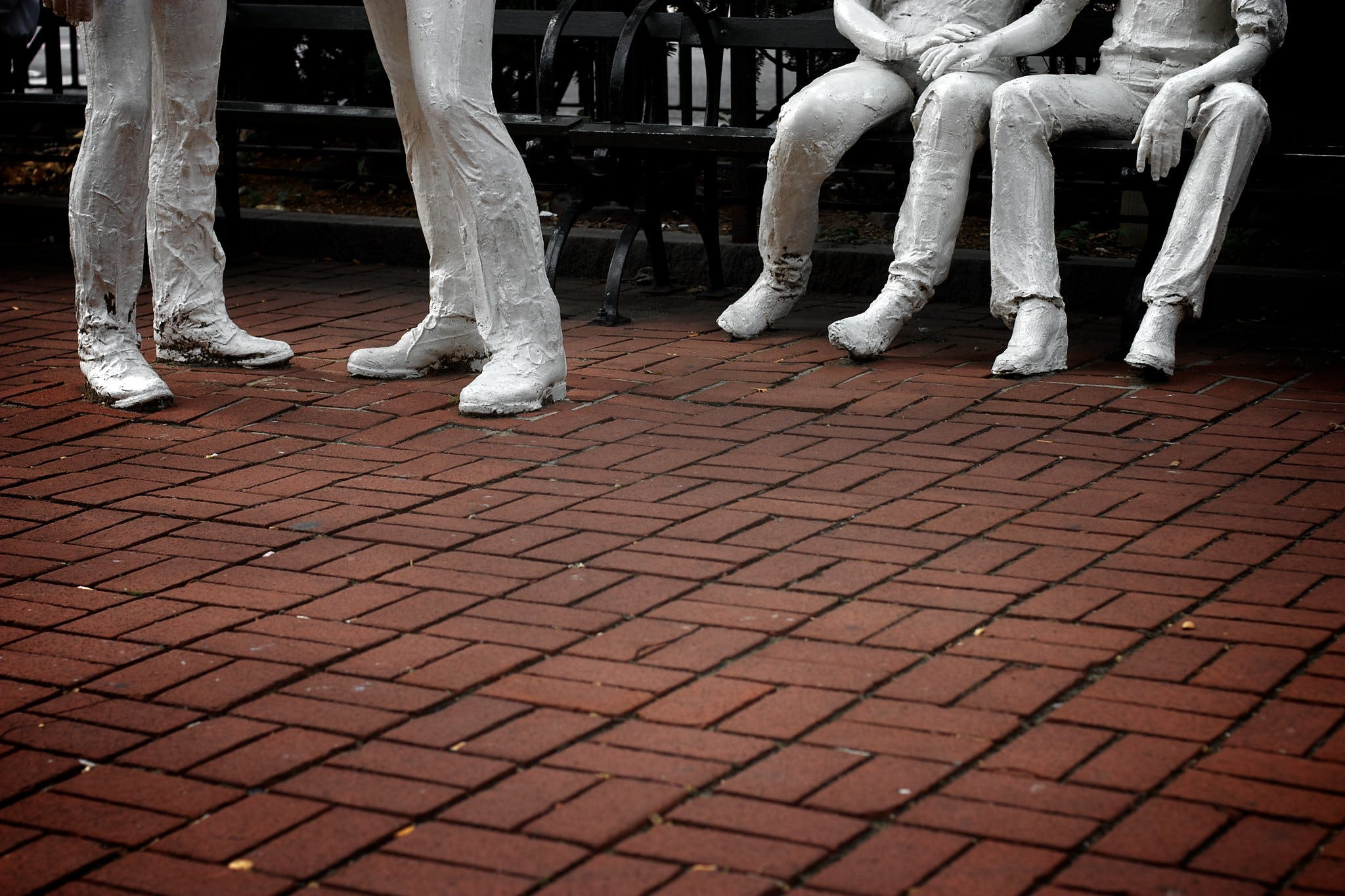 """A low shot of George Segal's """"Gay Liberation Monument"""" at the Stonewall Inn. Public sex played a key role in early queer history during the post-Stonewall era."""