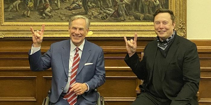 Greg Abbott and Elon Musk showing the Hook 'em Horns hand sign