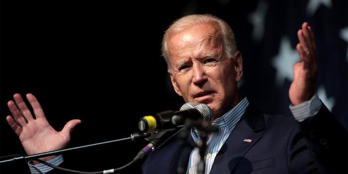 Joe Biden with his hands raised
