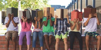 students hiding their faces behind books new york facial recognition school ban