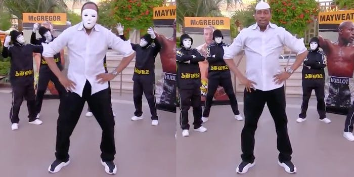 Stephen A. Smith dancing and wearing a white face mask
