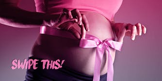 pregnant woman with ribbon tied into a bow around her belly