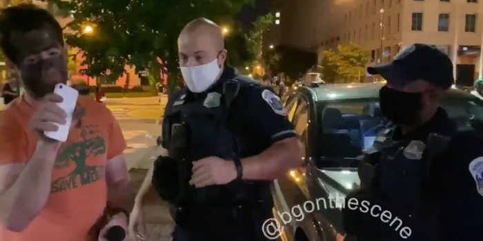 Man seen in blackface being escorted by an officer